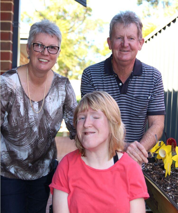Ellen with her parents, Pauline and Kim
