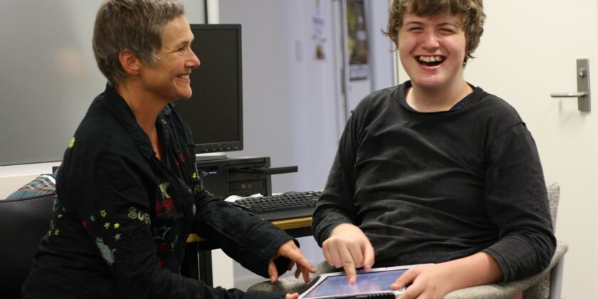 Eli and Gill in an office laughing