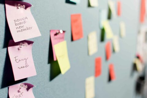 A pin board with postit notes