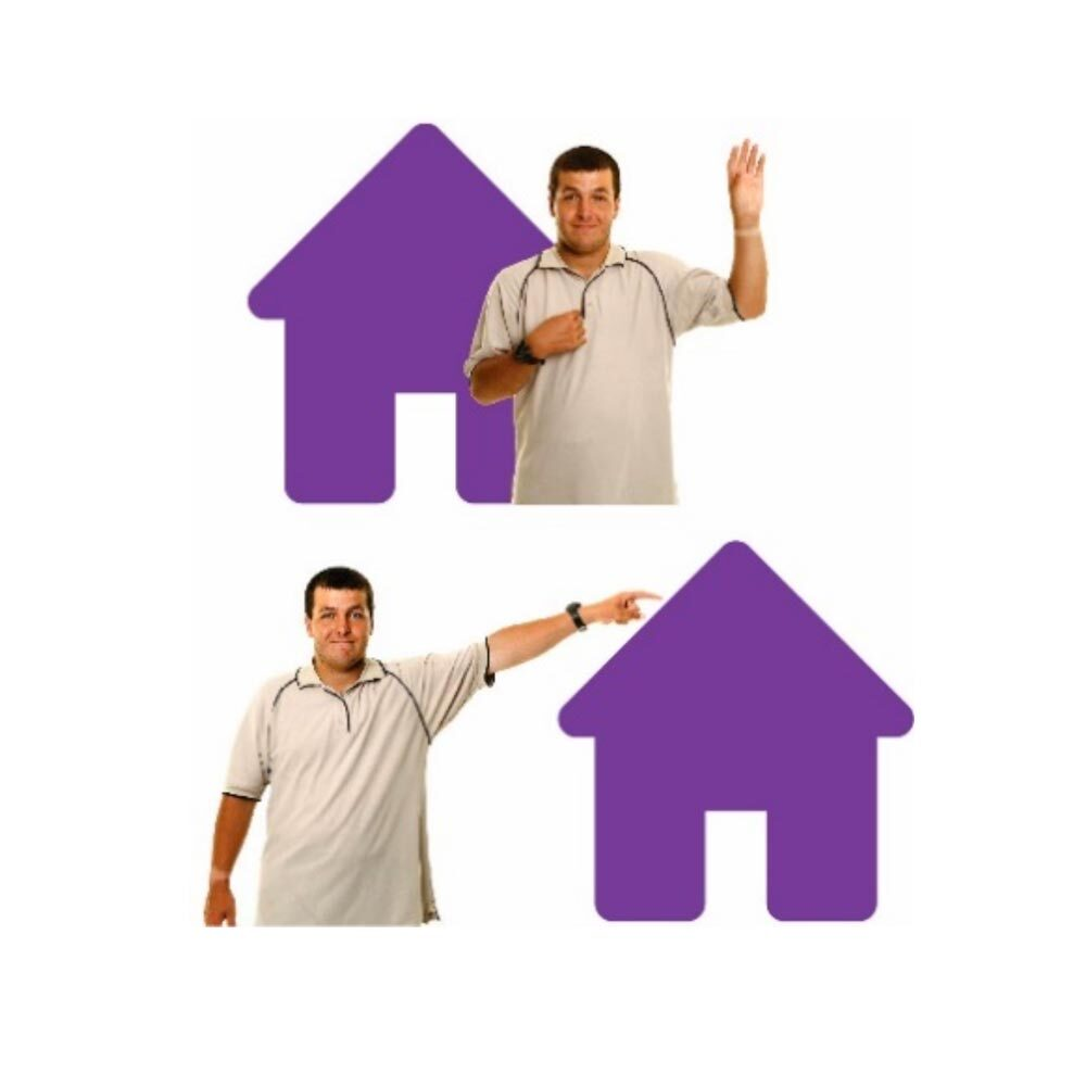 Man standing next to a house