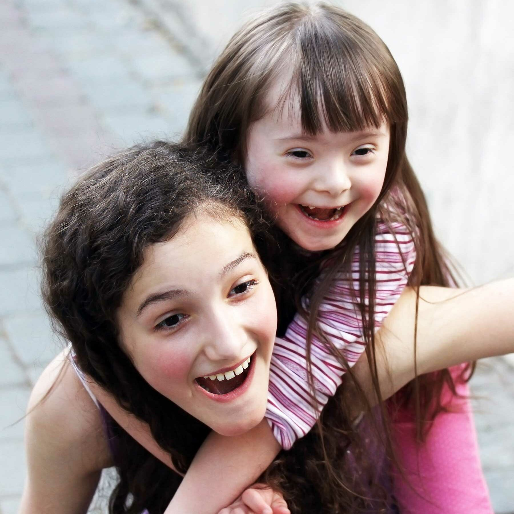 Two girls, one with Downs syndrome, playing
